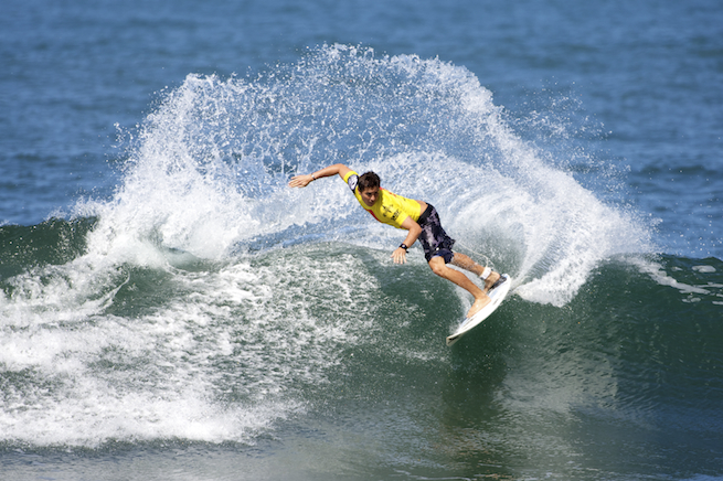 Joel Centeio sends five feet of spray off a two-foot wave en route to a ticket in the next round.