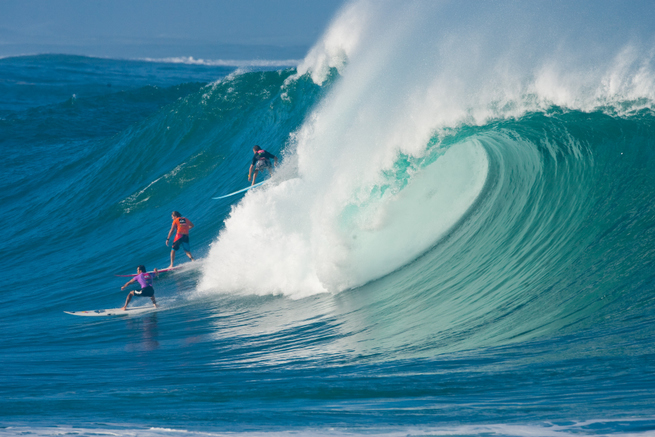 The more the merrier during the Eddie. Andy Irons in red.  Photo: Jimmicane