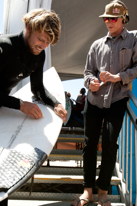 A Karate kid moment. Sensei Dane Reynolds teaches Kolohe Andino: wax the board.