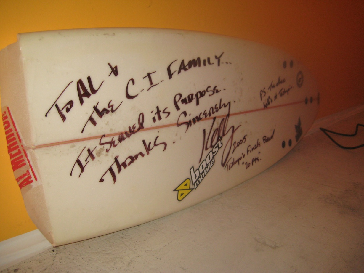 "Kelly's ""perfect 20"" board. The inscription reads: To Al and the CI Family. It served its purpose. Thanks. Sincerely, Kelly. P.S. The other half's in Teahupoo. Photo: Thomas"