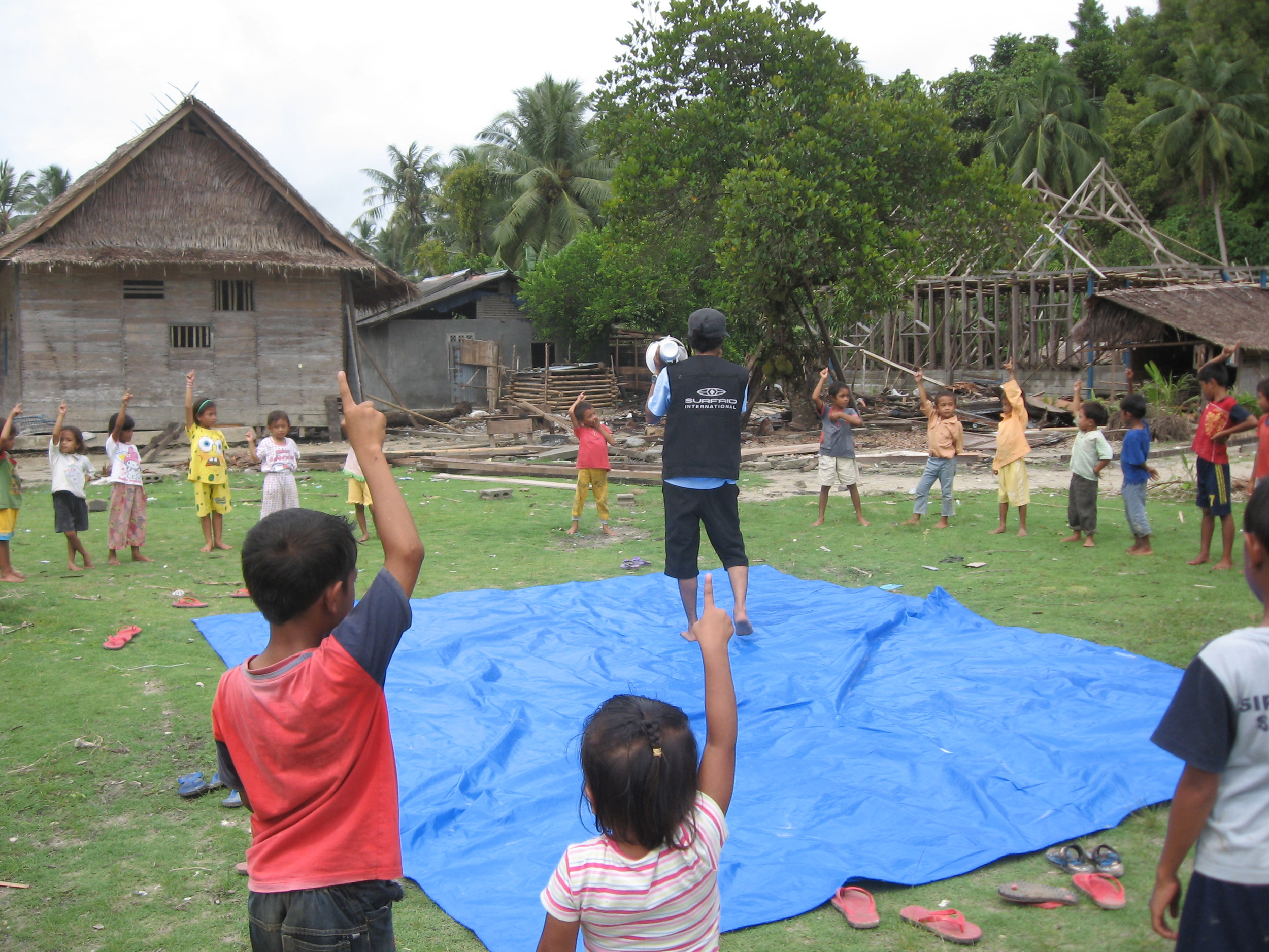 SurfAid psychologist Ian runs fun activities for the children of Masokut village, which was extensively damaged by the tsunami. Many children and parents are still traumatised. Photo: Stacey Howe/SurfAid
