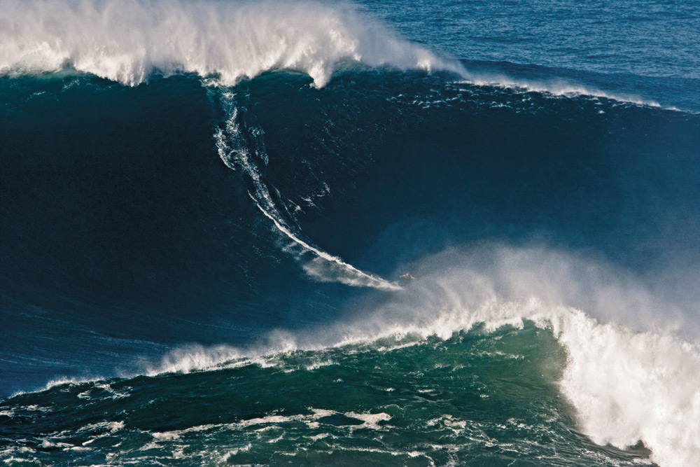 The wave in question: A Portuguese PR firm kicked off a media blitz when it circulated an unsubstantiated press release stating that this wave, caught by Garrett McNamara, was a 90-foot new world record. Photo: Caldeira