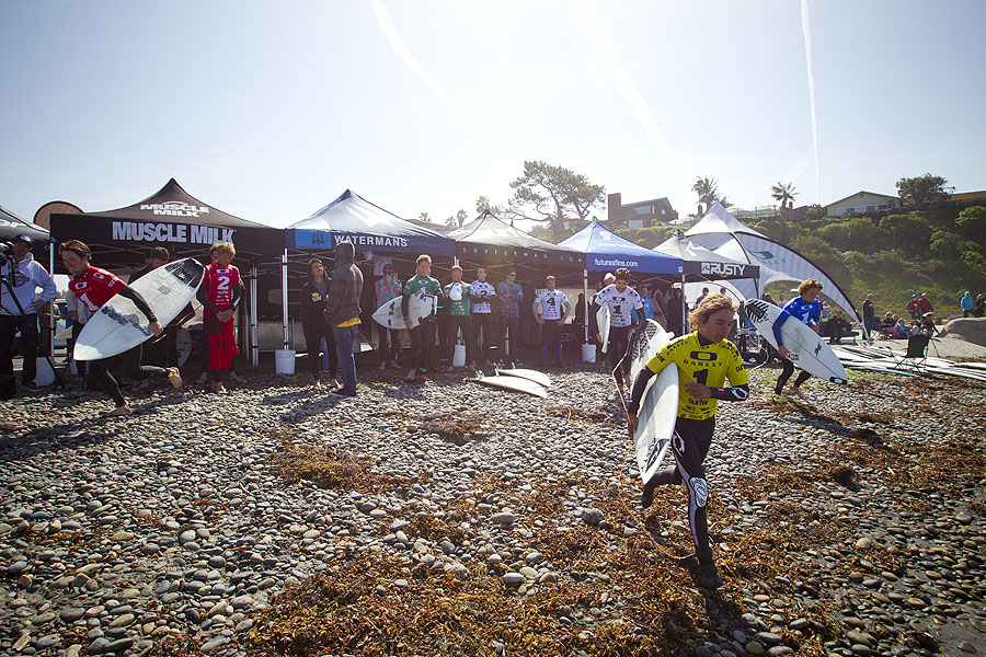 Jacob Szekely of Rusty Boardhouse runs out the water from the competitor's area at Seaside Reef. Photo: Ellis
