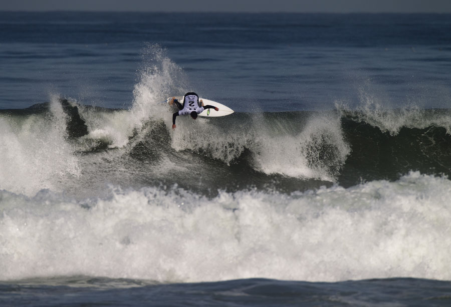 Ian Baksh from Clairemont Surf Shop follows through on a horizontal hack in the first heat of the day. Photo: Ellis