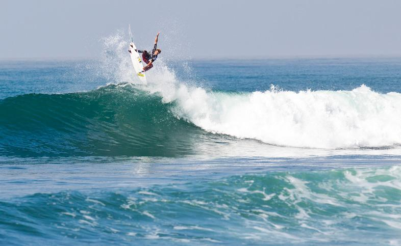 Unfortunately for Pat Gudauskas in Round 2, a solid air isn't enough to lock in a stellar wave score this year at Trestles. Photo: Courtesy of Hurley