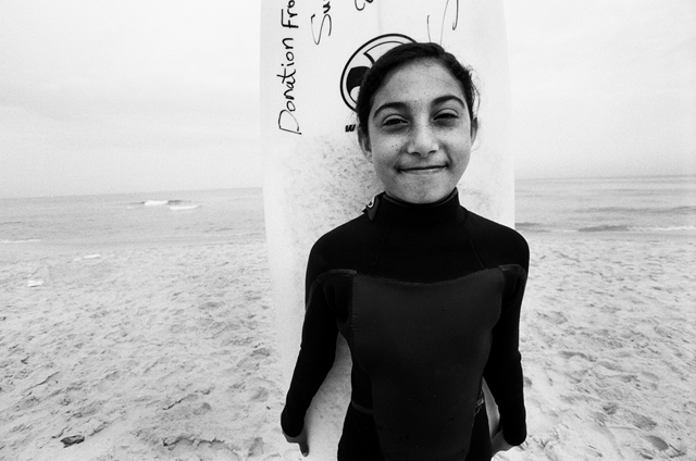 Sabah Abo Ghanem and her donated surfboard