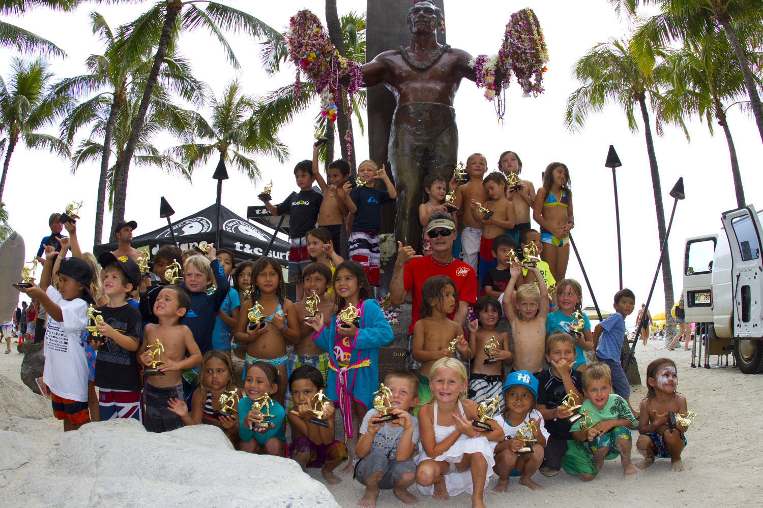 Contestants gather at the Duke statue for the 16th annual Town & Country Grom Contest. Photo: Manulele