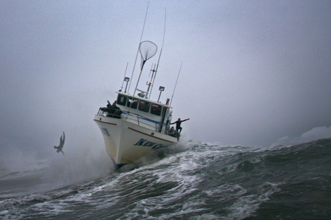 Man overboard — seriously, Mark Healey's boat got caught inside. Photo: Shannon Quirk