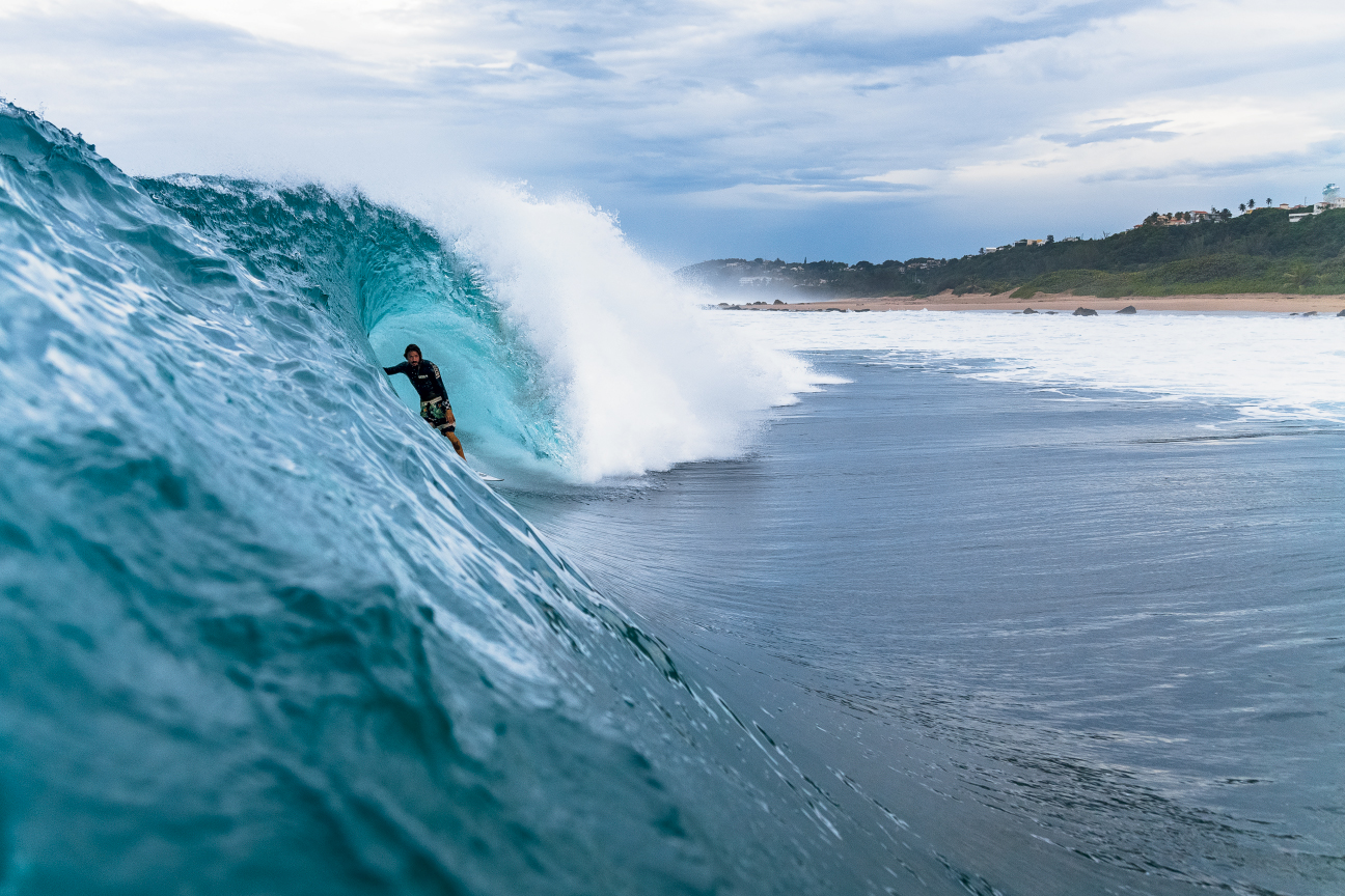 "A few weeks before the Columbus Landing protest, Hurricanes Matthew and Nicole lit up the northern shores of Puerto Rico with amazing surf. ""Middles was like Off The Wall during those hurricanes,"" says Dylan Graves, pictured here stalling in a very Hawaiian-looking cavern. ""It had such a long period—I think it was 6 feet at 16 seconds. And it had so much energy in it. When I was looking at it from my house in the morning, I could see corduroy lines to the horizon. We rarely get stuff like that."" Photo: Craig"